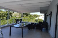 Covered patio with 12 seater table.JPG