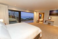 BEDROOM 1 master suite bedroom at dusk (5).JPG