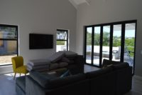 Open plan living and tv with doors to patio.JPG